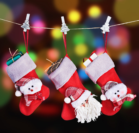 Christmas socks hanging on a background garlands blinking photo