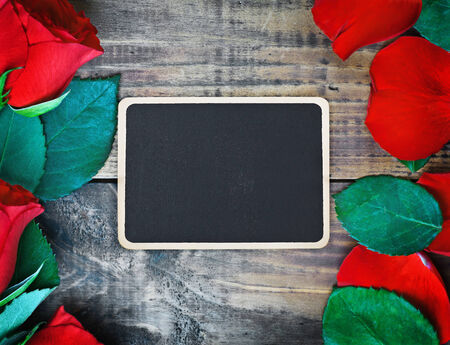 red roses and blackboard for congratulation photo