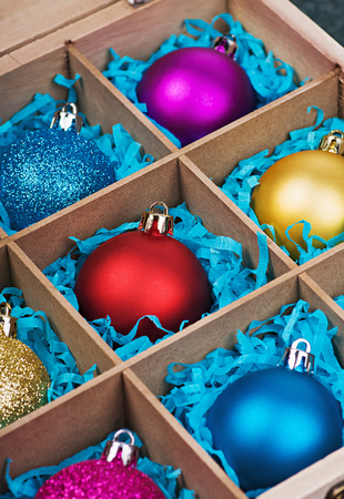 Christmas-tree balls in a wooden box photo