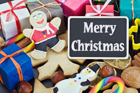 sweets and biscuits for Christmas and a black board with a greeting for the holiday photo