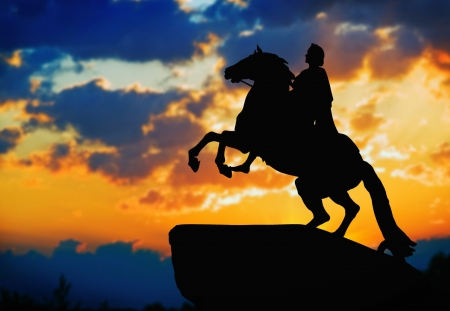 Statue of Peter Great, silhouetted against the sunset. St. Petersburg, Russia. Stock Photo