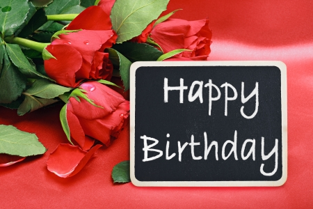 red roses and a blackboard with congratulations on his birthday photo