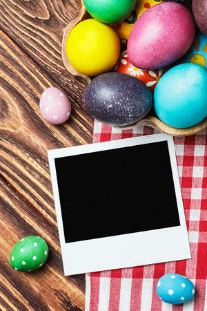 Easter colored eggs and an old picture frame photo