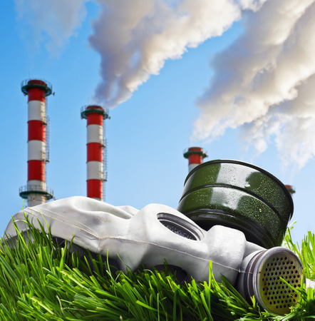 Smoking chimneys polluting the environment of the planet earth photo