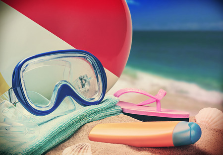 beach accessories on a background of sea and sand. toned image photo