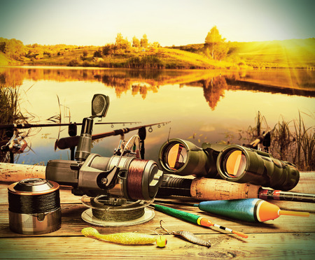 fishing tackle on a pontoon on the background of the lake