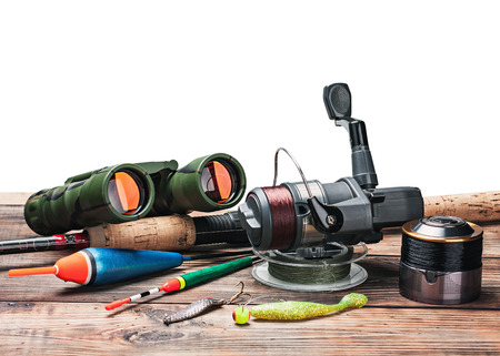 fishing tackle: fishing tackle on the table isolated on white background Stock Photo