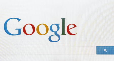 Moscow, Russia - February 27, 2014: Detail of front-page search engine Google. Google is one of the most popular search engines and is an American multinational corporation specializing in Internet-related services and products.