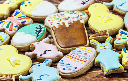 decorated Easter cookies laid out on the table. Focus on foreground photo