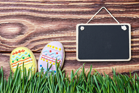 Easter homemade gingerbread cookie and a blackboard for congratulation photo