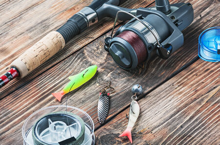 fishing tackle: fishing tackle on a wooden table Stock Photo