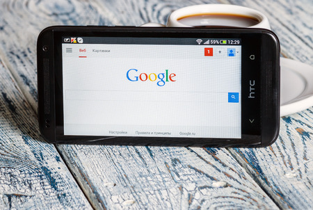 htc:  Moscow, Russia - March 18, 2014: Google app open in the mobile phone HTC.HTC Corporation main direction rapidly developing market of smartphones. Instagram free application sharing photos and videos