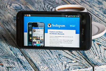 Moscow, Russia - March 18, 2014: instagram app open in the mobile phone HTC. HTC Corporation main direction rapidly developing market of smartphones. Instagram free application sharing photos and videos. Stock Photo - 27179223