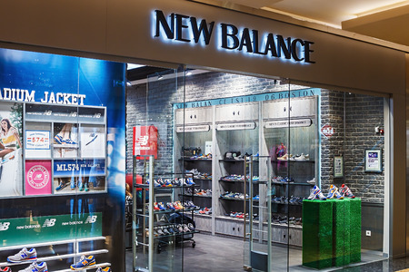 RUSSIA, MOSCOW - MARCH 10, 2014: New Balance shop windows in a shopping center, Moscow. The company was founded in 1906 as the New Balance Arch Support Company and is one of the worlds major sports footwear manufacturers