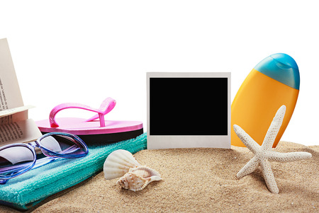 beach accessories and photos on memory isolated on white background photo