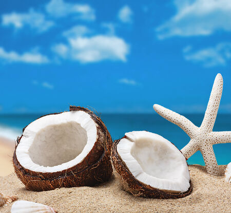 chopped coconut on sea-beach background photo