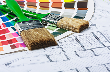 tools and accessories for home renovation on an architectural drawing photo