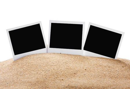 photo frame on the sea sand isolated on white  photo