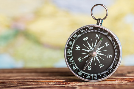 compass showing the direction on a map Archivio Fotografico