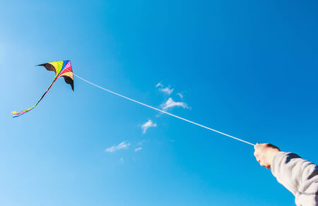 kite flying in a beautiful sky clouds. Focus on the kite photo