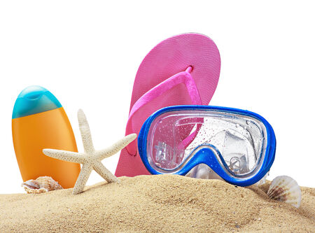 Beach items on sand isolated on white background photo