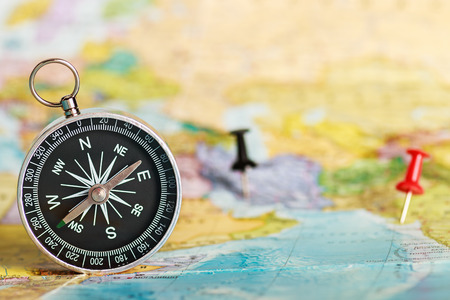 compass on the tourist map. Focus on the compass needle