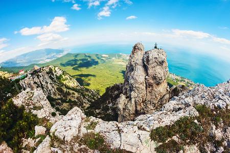 High rocks Ai-Petri of Crimean mountains. Black sea coast and blue sky with clouds. Russia. Photographed fisheye lens Stock Photo