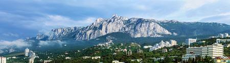 panorama of the morning mist over a large Yalta and Ai-Petri Mountain. Crimea. Russia photo