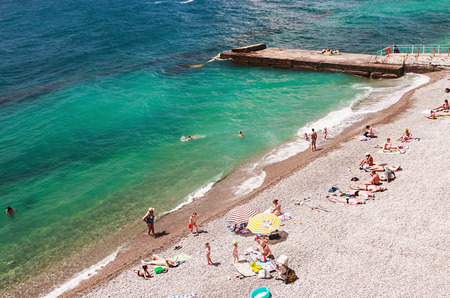 YALTA, Crimea - June 08, 2014: vacationers swim and sunbathe on the Black Sea in Yalta. Yalta resort town in the southern Crimea
