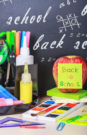 paper sticker with the words back to school and stationery photo