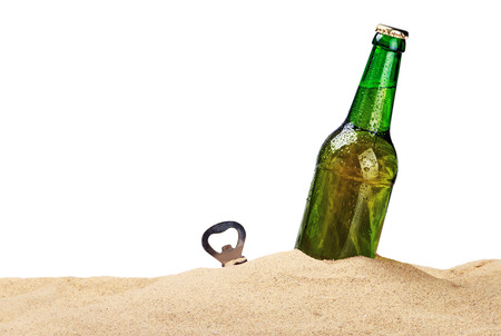 glasses in the sand: Beer bottle in the sand isolated on white background Stock Photo