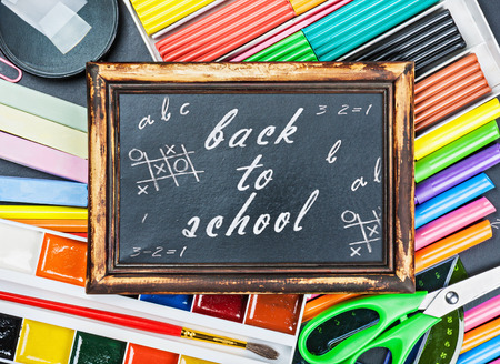 school supplies to the chalkboard with text photo