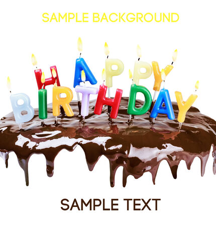 hundreds and thousands: lighted candles on a birthday cake isolated on white background. Empty white space above and below for sample background and text