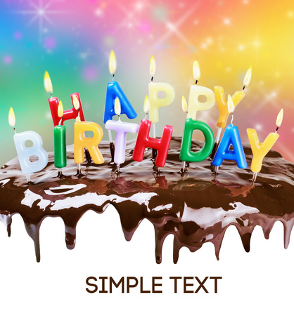 hundreds and thousands: lighted candles on a birthday cake. Bottom white space for text or congratulations. text font from open sources, free license of use