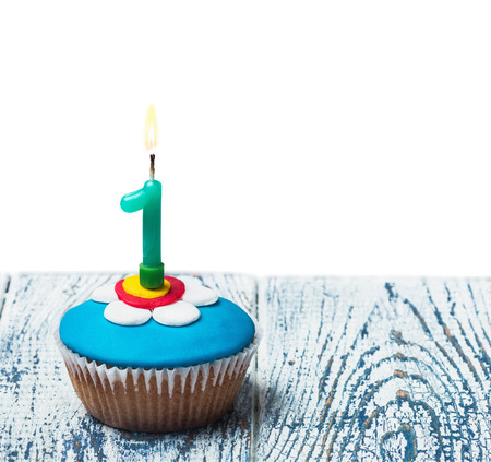 Cupcake with number one on white background isolated photo