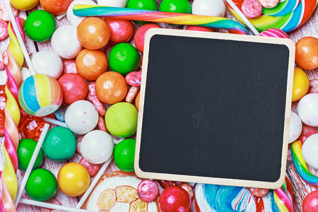 black board for writing greetings on candy and sweets photo