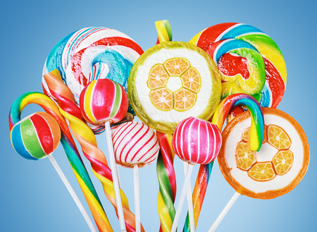 caramel candy: Colorful candies and sweets on a blue background