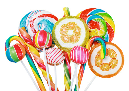 Colorful candies and lollipops isolated on white background photo