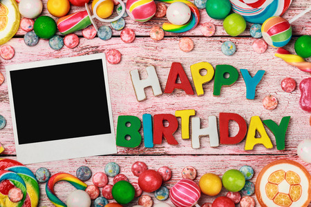 birthday background: letters of cookies and happy birthday photo frame