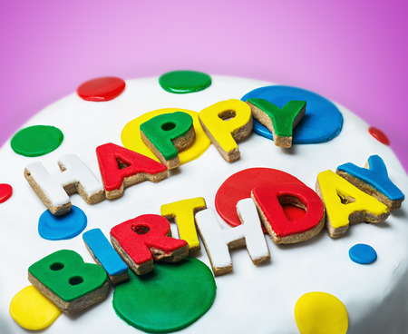 happy birthday congratulations from cookies in the glaze on the cake photo