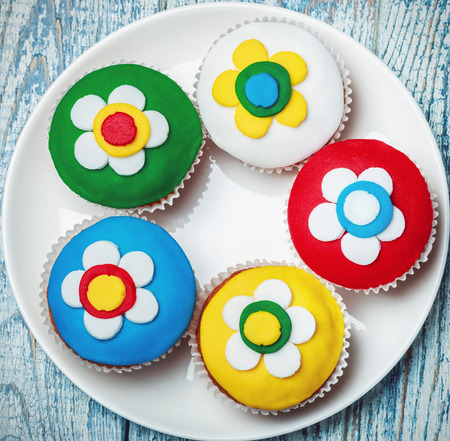 cupcakes with a floral pattern in a plate on the table photo