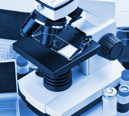 microscope and biological reagents to study in the laboratory  photo