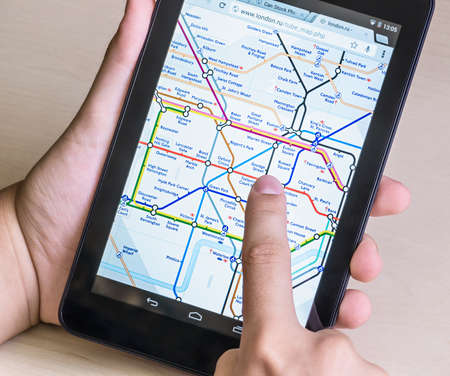 Moscow, Russia - August 26, 2014: London Underground diagram on the tablet. London Underground is one of the largest in the world, its network consists of 11 lines with a total length of 402 km.