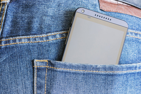 htc: Moscow, Russia -August 26, 2014: HTC Mobile Phone in a jeans pocket. HTC Corporation founded in 1997 by Cher Wang, HT Cho and Peter Chou, the priority was the rapidly developing market of smartphones. Editorial