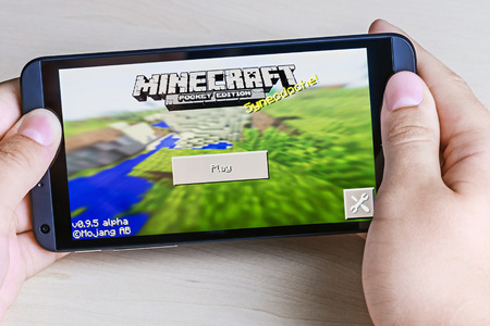 Moscow, Russia - August 26, 2014: Minecraft computer game in the genre with elements of survival sandbox and open world for smartphone htc. Developed by Swedish programmer Markus Persson, manufactured by the company Mojang.  에디토리얼