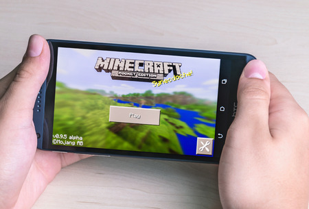 Moscow, Russia - August 26, 2014: Minecraft computer game in the genre with elements of survival sandbox and open world for smartphone htc. Developed by Swedish programmer Markus Persson, manufactured by the company Mojang.  報道画像