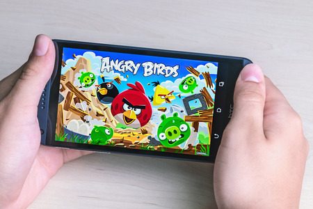 Moscow, Russia - August 26, 2014: Angry Birds computer game developed by Finnish company Rovio Entertainment first released in 2009. It sold over 2 billion copies across all platforms