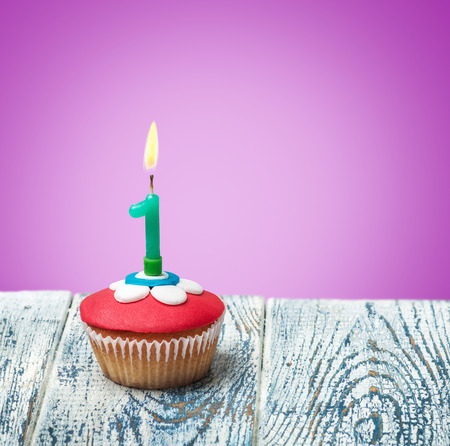 birthday cupcakes: Cupcake with number one on a purple background. birthday greetings