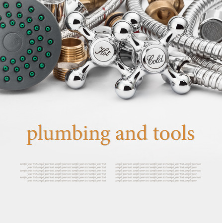 plumbing and tools on a gray background. Empty white space above and below for sample background and text photo