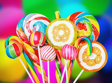 Colorful candies and sweets in the background of balloons